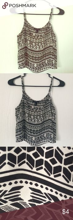 Forever 21 Tribal Crop Top Black&White tribal print spaghetti strap crop top. Loose fit. Adjustable straps. Slightly worn. Small tear on the back right shoulder. feel free to make an offer! Forever 21 Tops Crop Tops