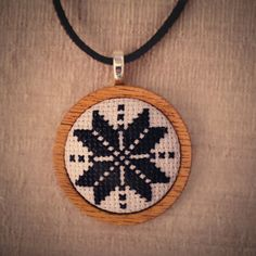 Hand Embroidered Snowflake Necklace by HandStitchedWithLove