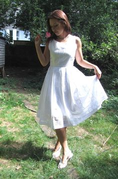 This oh-so-pretty dress is handmade in a beautiful embroidered white organic cotton fabric. It's a simple feminine 50's shape - great for summer parties, honeymoons and holidays or an alternative wedding dress for a free-spirited bride.It has a gently scooped neck and fitted bodice with a pleated full skirt. It is lined in white organic cotton.This dress is made to order in sizes XS - XL Standard Sizes in inches:XS (UK Size 8, US Size 4) Bust: 32 - 33, Waist:26-27,S (UK ...