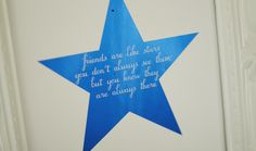 """Friends are like stars. You don't always see them, but you know they are always there"" foil print, perfect for a baby's nursery or child's room. Pictured in blue with a white background."