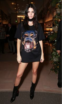 Kendall Jenner wears a Givenchy t-shirt dress, skinny scarf, and glove boots