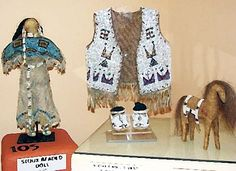 museum-of-native-american. - Sioux Doll, Child's vest and moccasins and a leather horse with beaded saddle blanket