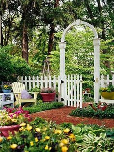 A classic white picket fence makes a charming addition to any garden, especially when paired with a matching arbor and gate. A low fence such as this gives definition to the space, but still allows unobstructed views. A pathway and arbor beckon further exploration. (I could do the fence in the front and add the arbor for my tiny back/side garden)...