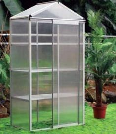 """Hot House Haven 3 Greenhouse by EarthCare Greenhouses by EarthCare Greenhouses. $279.99. Constructed with clear polycarbonate panels, which are extremely safe, virtually unbreakable, and durable.. Dimensions: 22.8"""" L x 38.6"""" W x 73.6"""" H. Aluminum Frame with three Aluminum Shelves. Ideal for starting Seeds. 4 MM UV resistant Double Wall Polycarbonate. Ideal for any gardener and great for using in small spaces: Patios, balcony or deck."""