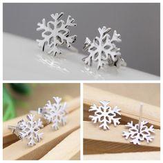 Snowflake Earrings Silver snowflake earrings. New in package, no tag. Jewelry Earrings