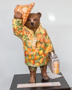 Why Paddington Bear Statues Have Taken Over London - Condé Nast Traveler  The Journey of Marmalade  Hugh Bonneville plays Mr. Brown, the dad of the family that adopts Paddington. His colorful outfit is inspired by Paddington's favorite food, marmalade.