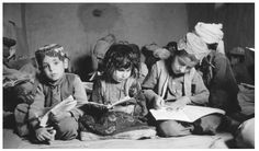 Afganistan culture and traditions. - A group of children read in a school in Arghandab, Afghanistan. Although education is valued in Afghanistan, only 5 percent of Afghani children receive a primary education.