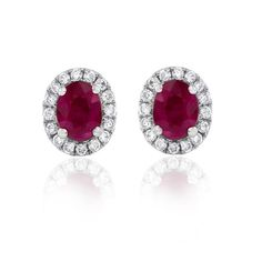 Product Information Specifications Warranty & Care Instructions How to Buy Surprise and delight with this stunning pair of Aura ruby and diamond stud earrings. Crafted for pierced ears, these white gold earrings make a stunning gift. The oval rubies a Ruby Jewelry, Ruby Earrings, Keep Jewelry, Diamond Earrings, Timeless Engagement Ring, Designer Engagement Rings, Matching Wedding Rings, Wedding Rings For Women, Diamond Studs