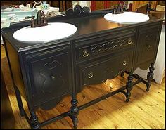 This Vintage sideboard is now a beautiful black double sink vanity designed and refinished for your bathroom. As you can see from the pictures, the legs and cross-bars give a stylish appeal. The carved doors and drawers as well as the back-splash r Buffet Antique, Antique Sideboard, Sideboard Ideas, Antique Dressers, Antique Furniture, Antique Brass, Double Sink Vanity, Vanity Sink, Double Sinks