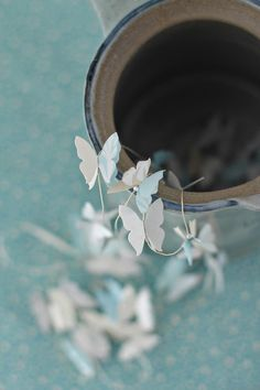 Butterfly Garland - Would look pretty made out of vellum edged in silver glitter and hung from a white gauzy bed canopy!