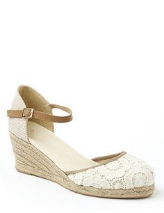 6b94f4ebd77 Fresh espadrille sandals feature delicate floral crochetwork at the closed  toe. Wicker-like fabric