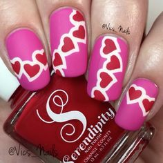 Here is my Valentine's Day hearts tutorial! 💞❤💋💅🏻 Polish used is Pink Poinsettia and Big Red Bow from @serendipitypolish and Carpe Diem from @cirquecolors. Matte topcoat from @opinewzealand. Heart nail vinyls from @vinailicious!  Clean up brush is Fabulously Flat from @mitty_burns ✨✨ Get 10% off your purchase at www.mitty.com.au with my code VICSNAILS ✨✨ Song is Love Drunk by Boys Like Girls