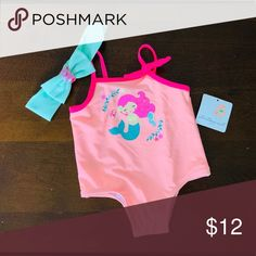 BNWT 12 month girl's mermaid swimsuit Starting Out brand. This is never worn, brand new with tags. Including a matching headband. 12 month pink with mermaid. Starting Out Swim One Piece Mermaid Swimsuit, 12 Months, Athletic Tank Tops, Kids Shop, Swimsuits, One Piece, Brand New, Tags, Pink