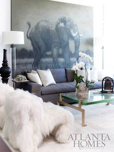Display What You Love. An oversized elephant print makes the room. Interior Designer: unknown.