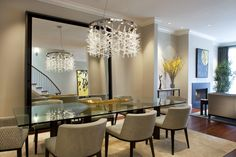 : New Light Brown Themed Home Dining Room Interior Decorated With Crystal Chandelier Above Glass Table