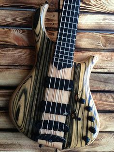 Mayones Slogan 5 Custom Shop Bass, Ebony Black & White top, Swamp Ash body back with Wenge middle, 9-ply Hard Rock Maple / Mahogany neck-thru-body section, Transparent Natural Gloss finish