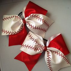 Baseball cheer bow by TopKnotDesignsBows on Etsy, $12.00 Can be personalized with team and name for $3 extra and free shipping.