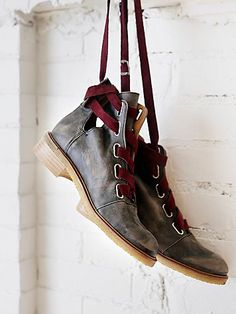 Jenning Lace Up Boot | Distressed leather ankle boots with side cutouts. Laced with wide suede ribbons that wrap around ankle and buckle closed; adjustable. Spanish crafted with exposed back zip closures.  *By Free People