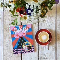 Arty magazine, artisan coffee and flowers