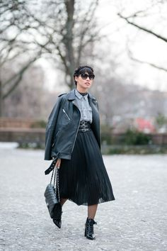 Learn how to pull off a skirt in the winter | outfit ideas via @STYLECASTER | pleated midi skirt and booties