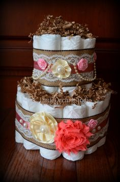 This listing is for shabby Chic style diaper cake embellished with burlap and lace with shabby chic fabric flower and bunch of other satin,