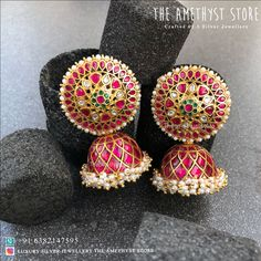 A pair of silver with gold plated earrings are studded with semi-precious stones. Gold Jhumka Earrings, Silver Earrings Online, Indian Jewelry Earrings, Silver Jewellery Indian, Jewelry Design Earrings, Gold Earrings Designs, Gold Jewellery Design, Ear Jewelry, Gold Jewelry