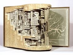 Artist Brian Dettmer Carves Old Books into Intricate Narrative Sculptures
