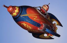 Moon Rocket Tin Toy -- I would love to see what goes on with the wind-up. It's just a great design!
