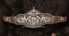 Enchantingly luminous diamond odiyanam is perfect for the princess in your life. The intricate latticed piece has floral and peacock designs interspersed with emeralds and ruby highlights. Latest Jewellery, Bead Jewellery, Diamond Jewelry, Gold Jewelry, Diamond Pendant, Jewelry Trends, Jewelry Sets, Vaddanam Designs, Indian Jewelry