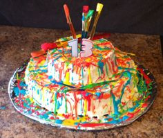 """Our daughter's 13th birthday cake- warmed coloured icing and drizzled it all over. """"Artist themed """" party"""