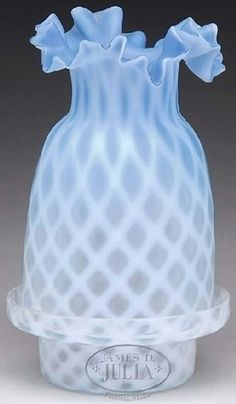 Fairy lamp, blue and white satin glass, ruffled top dome shade with diamond pattern and two notch vents on base of shade resting in a crystal and white diamond pattern lamp base. Circa 1876-1925