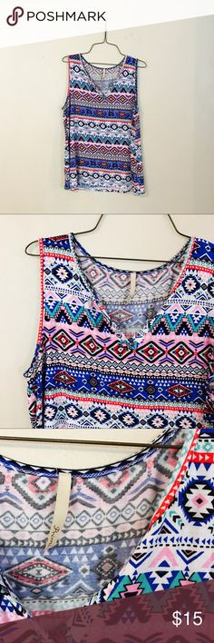 Multicolor Tribal Top Great used condition. Only worn a couple of times. Multicolor Tribal design. Split Neck style front. Super stretchy material. Purchased on modcloth. Tops Blouses
