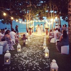 A lovely beach wedding... without worrying about getting sand in your shoes.  And the chairs are low maintenance & can be turned every which way.  Love this!