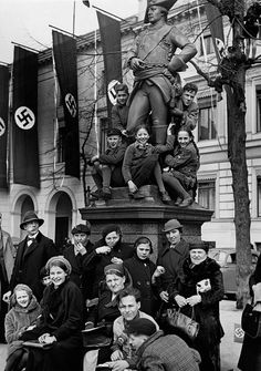 After the 'Anschluss' of Austria and the German Reich onlookers at the Wilhelmplatz at the memorial to a Prussian officerwaiting for Hitler's convoy...