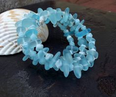 Handmade Beach Blues Wrap Bracelet: Ocean Surf Sea Glass Cuff, Beach Pebble Stacked Bracelet, Resort Wear Jewelry, Nautical Beaded Bracelet  SherryKayDesigns Enter shop here: https://www.etsy.com/shop/SherryKayDesigns?  Features:  6mm x 9mm soft, ocean blue man made sea glass finish freeform pebble beads.  4mm round silver plated cutout spacer beads.  Silver plated memory wire.  Comes elegantly gift boxed.  Please note my shop policies and purchases from SherryKayDesigns can be made through…