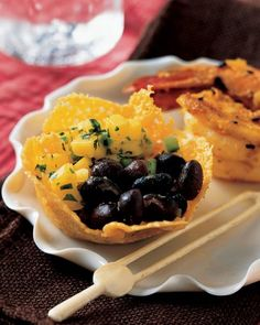 Beastly Beans with Mango Salsa in Cheddar Cups and Spooky Spiced Shrimp - A serving of beastly beans -- black beans with mango salsa in a cheddar cup -- is just enough to raise the spirits of your guests this Halloween. Pair with spooky shrimp, covered with dozens of black sesame seeds doubling as eyes that watch your guests wherever they go.