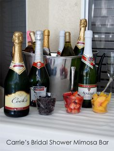 Mimosa Bar - wine bucket, champage, fruit set up for Bridal Shower