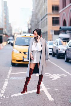 This outfit is the epitome of cool; Danielle Bernstein takes the velvet trend to the next level in these amazing knee high boots. She keeps the rest of her look simple and neutral so her boots do all the talking. These boots would also look great in...