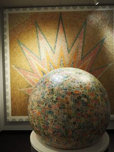 6 places to visit in Omaha, Nebraska: The largest ball of stamps exhibit itself is inside of a museum introducing Boy's Town– a town created by a Catholic priest as a way to create a home for young men who were orphaned or didn't have homes.  The stamp ball was originally started around a golf ball to give the children within Boy's Town a hobby.