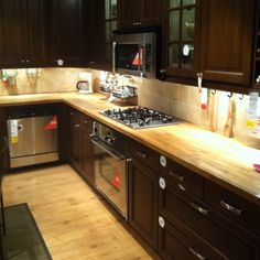 Dark Cabinets With Light Butcher Block Counters