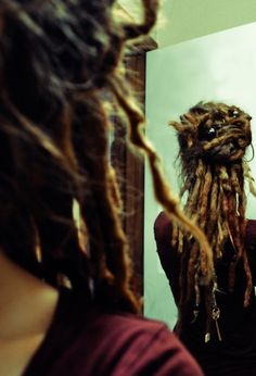 Someday my dreads will be long and beautiful, and I'll be able to do pretty updo's like this. I love this.