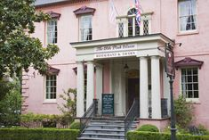 Pink House in Savannah.Take your love of Halloween up a notch by visiting some of the most haunted cities in North America. Luckily, these cities also offer a wealth of other activities just in case you need a break from being scared Visit Savannah, Savannah Chat, Savannah Georgia, Haunted Hotel, Most Haunted, Haunted Towns, Scary Places, Places To Go, Savannah Restaurants