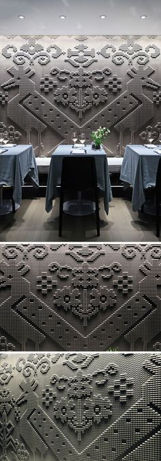Wall Decor Ideas - A chiseled natural stone tapestry covers the wall of this modern restaurant.
