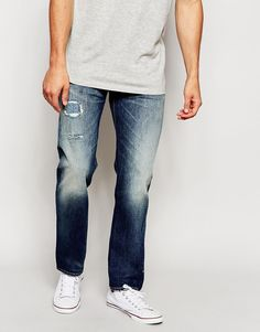 """Jeans by Levi's Vintage Clothing Non-stretch heavyweight denim Distressed wash Classic five pocket styling Button fastening, zip fly Mid-rise Straight fit - cut with a straight leg Machine wash 100% Cotton Our model wears a 81cm/32"""" regular and is 185.5cm/6'1"""" tall"""