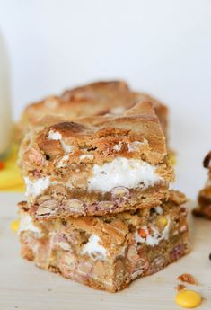 Fluffernutter Bars with peanut butter chips, Reese's Pieces candies, marshmallow and more from Confessions of a Cookbook Queen website.
