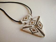 Open Triangle with bezel made with peyote stitch.
