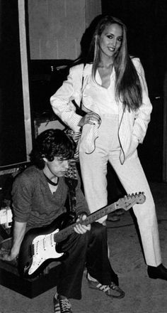 Mick Jagger and Jerry Hall. H looks like such a kid and she looks like such a woman