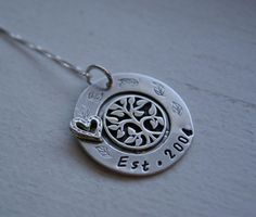 Family tree Hand stamped disc with soldered sterling silver heart  necklace Personalized sterling silver mothers pendant washer. $65.00, via Etsy.