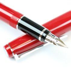 Pilot Falcon fountain pen in red closeup on nib https://www.penchalet.com/fine_pens/fountain_pens/namiki_falcon_fountain_pen.html