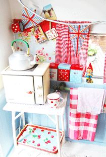 """This is a shot from Happy's vintage Caravan. You MUST check out her blog """"Happy Loves Rosie"""". You'll want to hole up and hide in all the glorious vintage red and aqua!"""